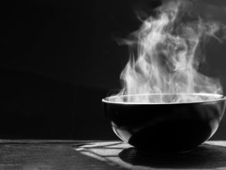 steaming rice bowl of soup