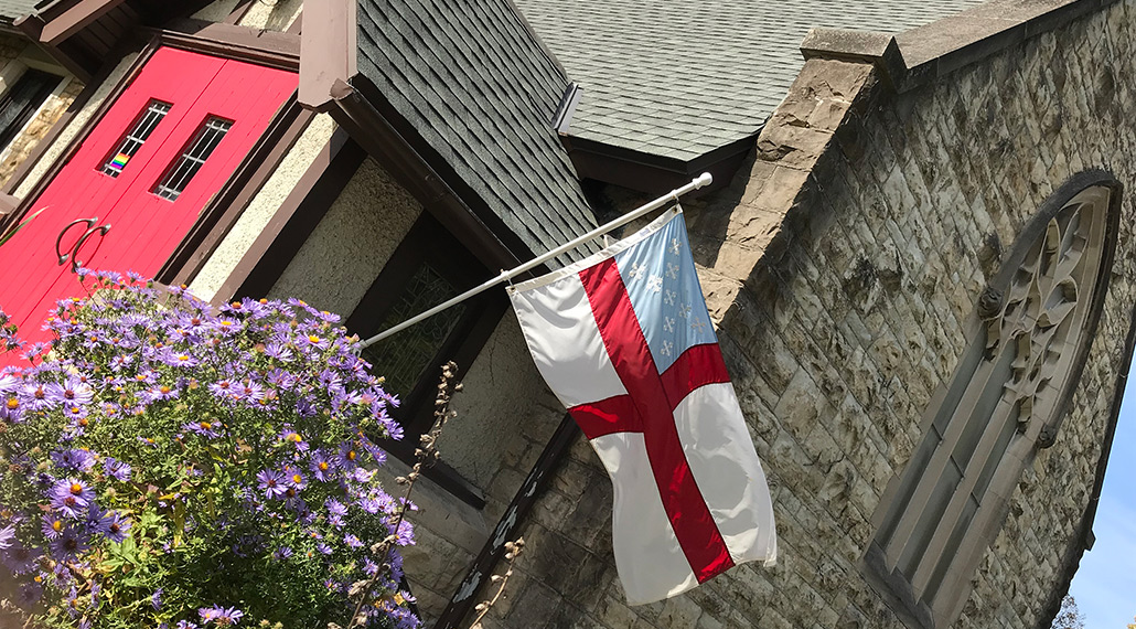 St. Elisabeth's red front door and the Anglican flag