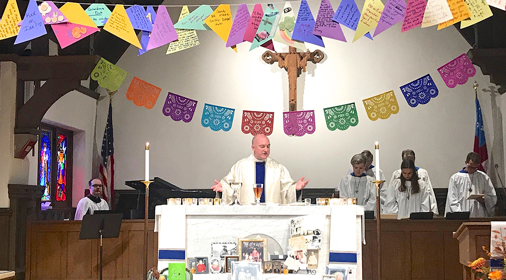 Rev. Kevin during a service