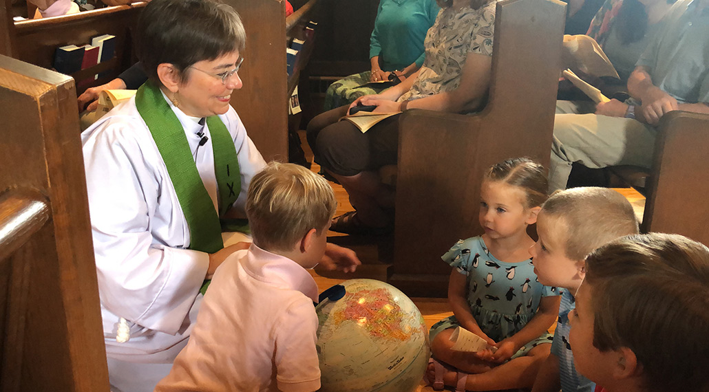 Rev. Daphne interacting with children during a service