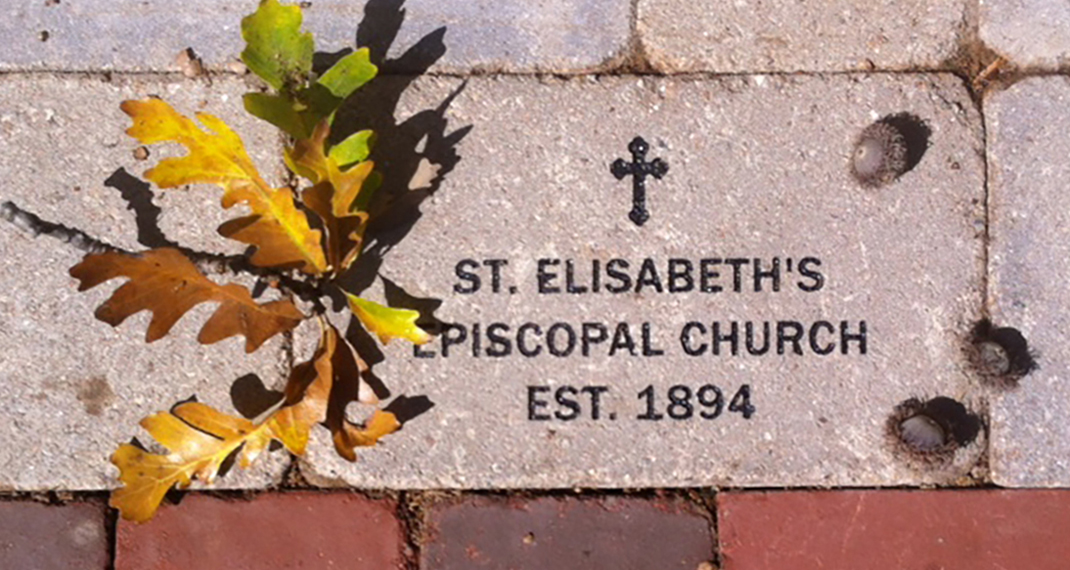 paving brick commemorating founding of church in 1894